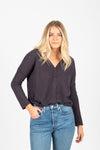 The Huron Waffle Tie Front Blouse in Charcoal, studio shoot; tucked in front view