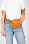 The Diva Straw Flap Belt Bag in Brown