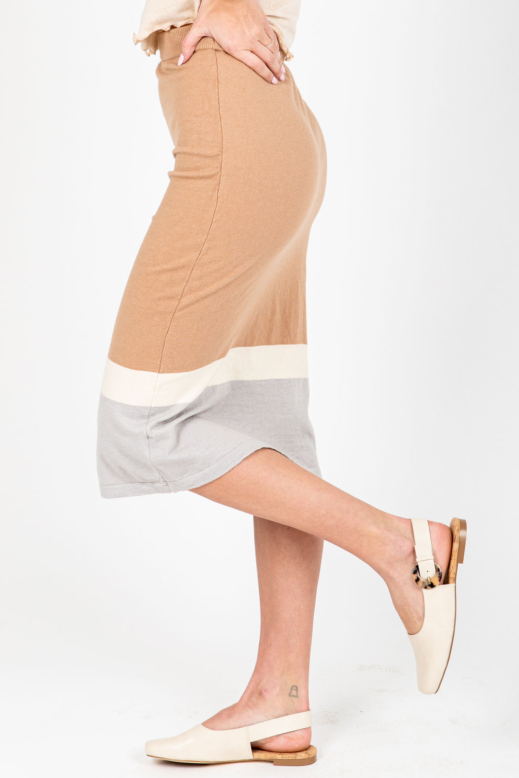 The Ross Striped Knit Skirt in Taupe, studio shoot; side view