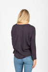 The Huron Waffle Tie Front Blouse in Charcoal, studio shoot; back view