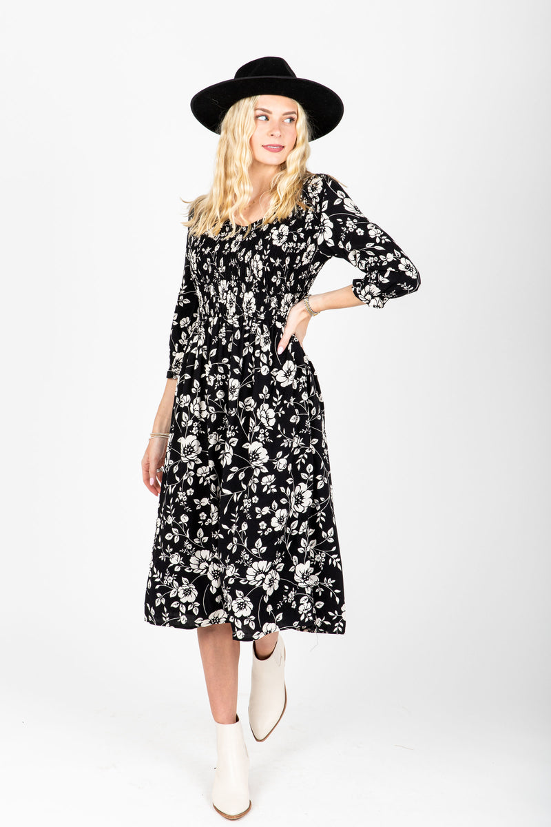 The Annie Smocked Floral Dress in Black, studio shoot; front view