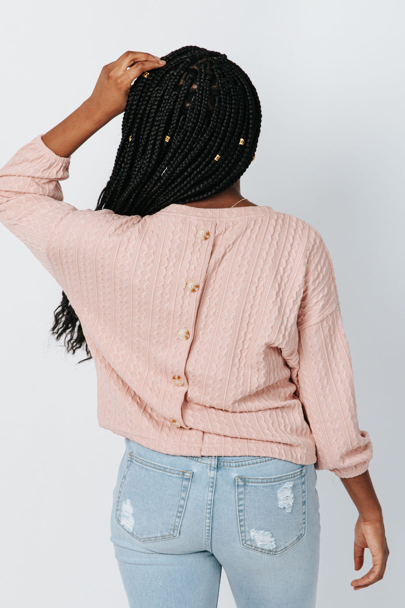 The Lizzie Knit Sweater in Dusty Pink, studio shoot; back view