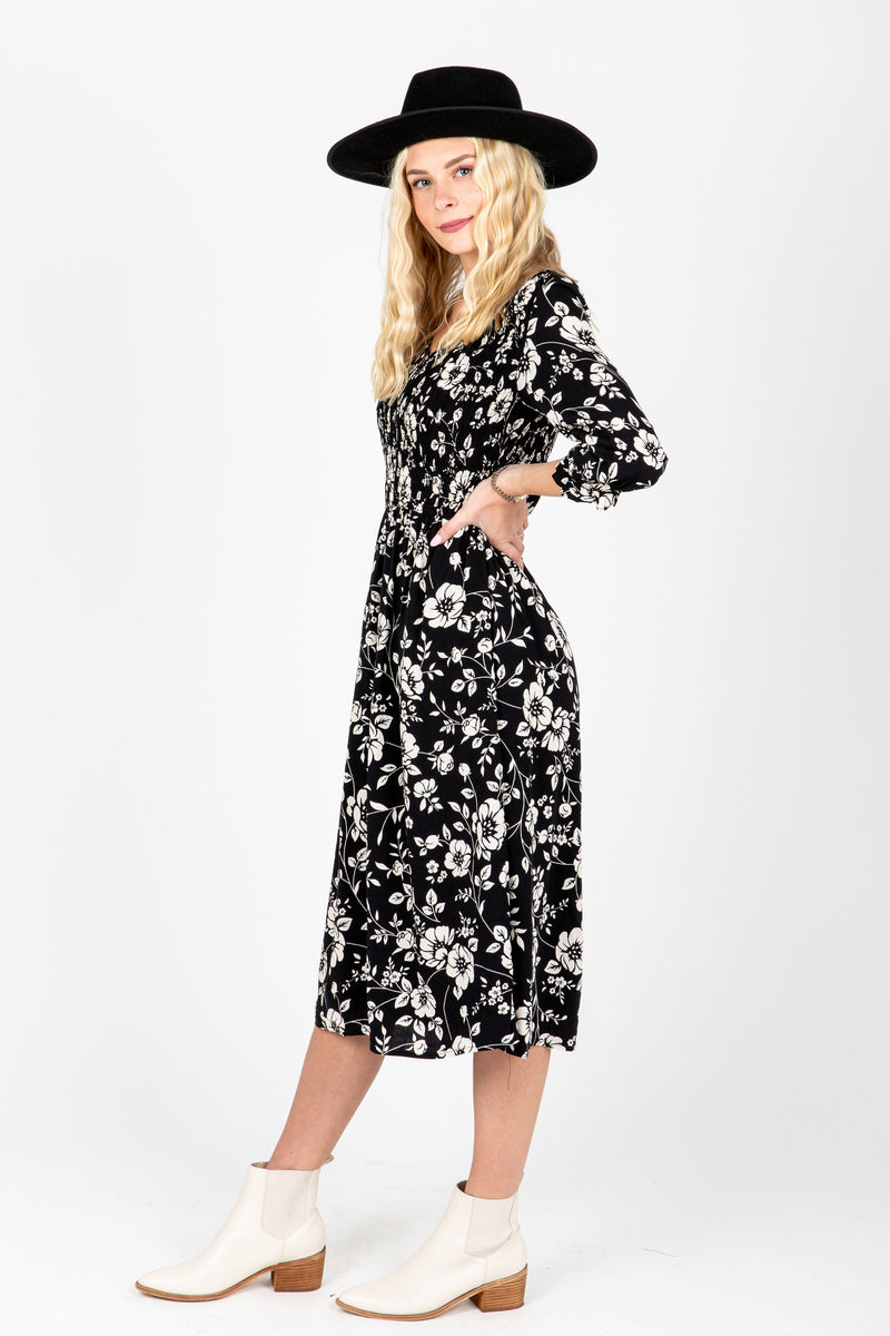The Annie Smocked Floral Dress in Black, studio shoot; side view
