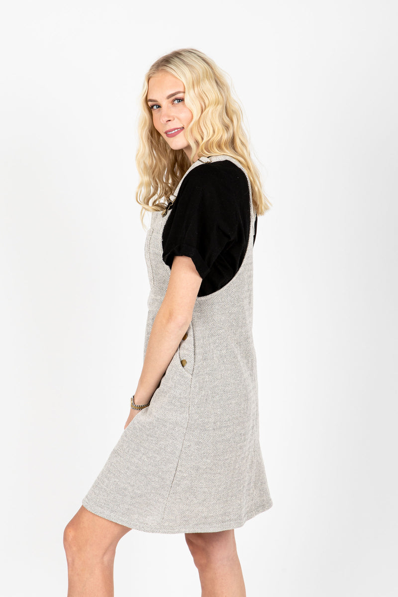 The Addie Knit Jumper Dress in Grey, studio shoot; side view