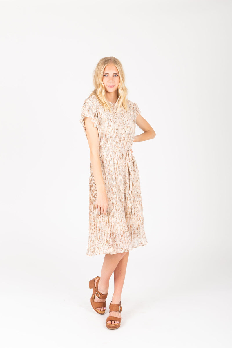 The Harvey Floral Pleated Dress in Taupe, studio shoot; front view