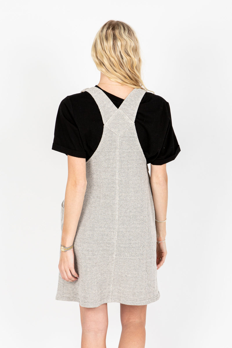 The Addie Knit Jumper Dress in Grey, studio shoot; back view