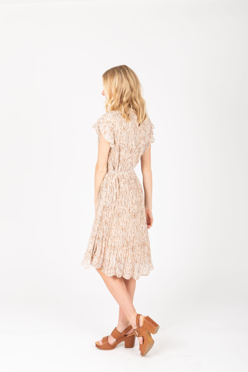 The Harvey Floral Pleated Dress in Taupe, studio shoot; side view