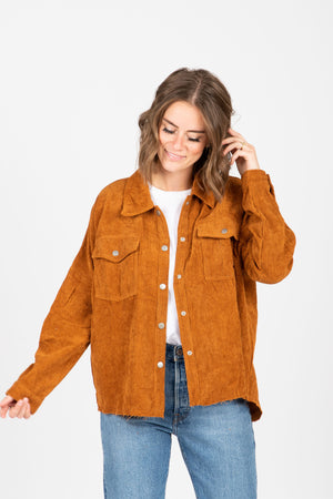 The Icone Frayed Corduroy Jacket in Rust, studio shoot; front view