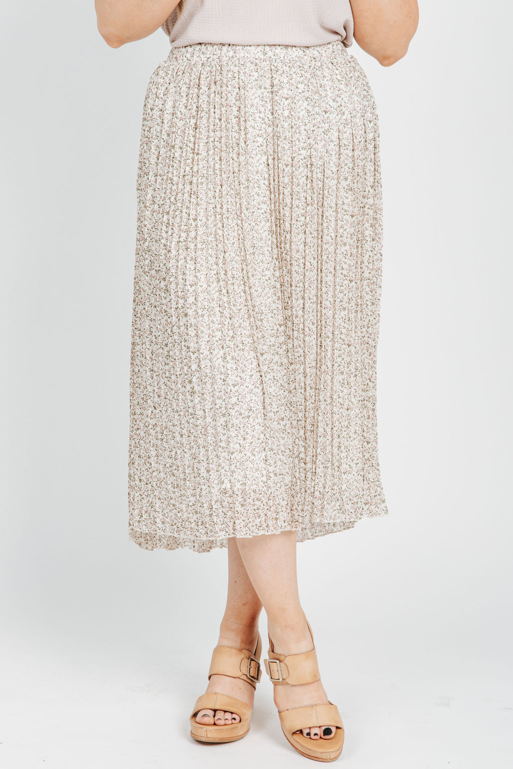 The Loraine Pleated Floral Skirt in Ivory, studio shoot; front view