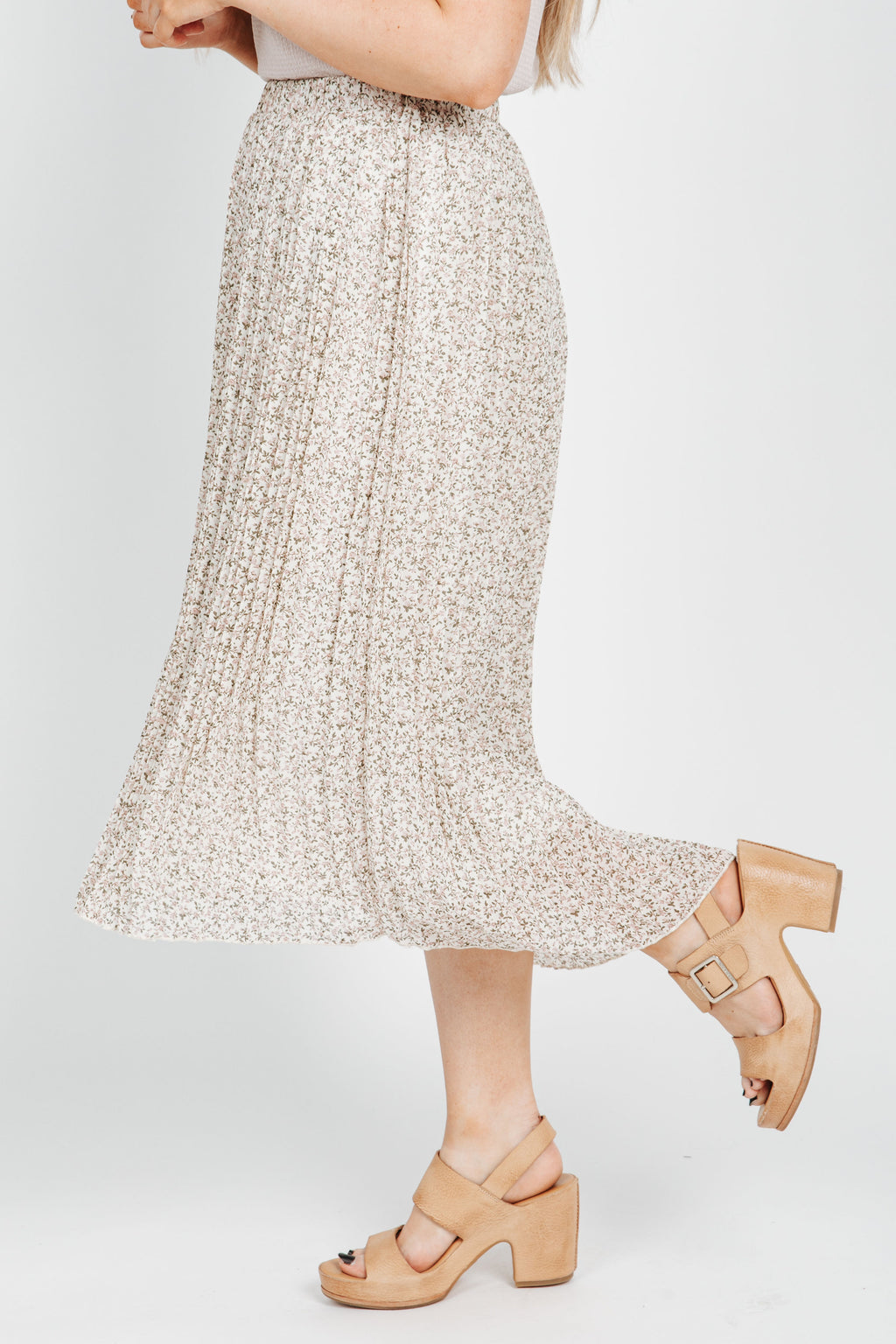 The Loraine Pleated Floral Skirt in Ivory, studio shoot; side view