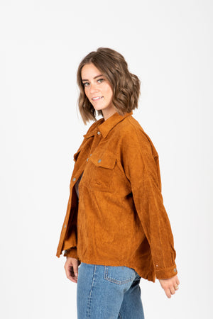 The Icone Frayed Corduroy Jacket in Rust, studio shoot; side view