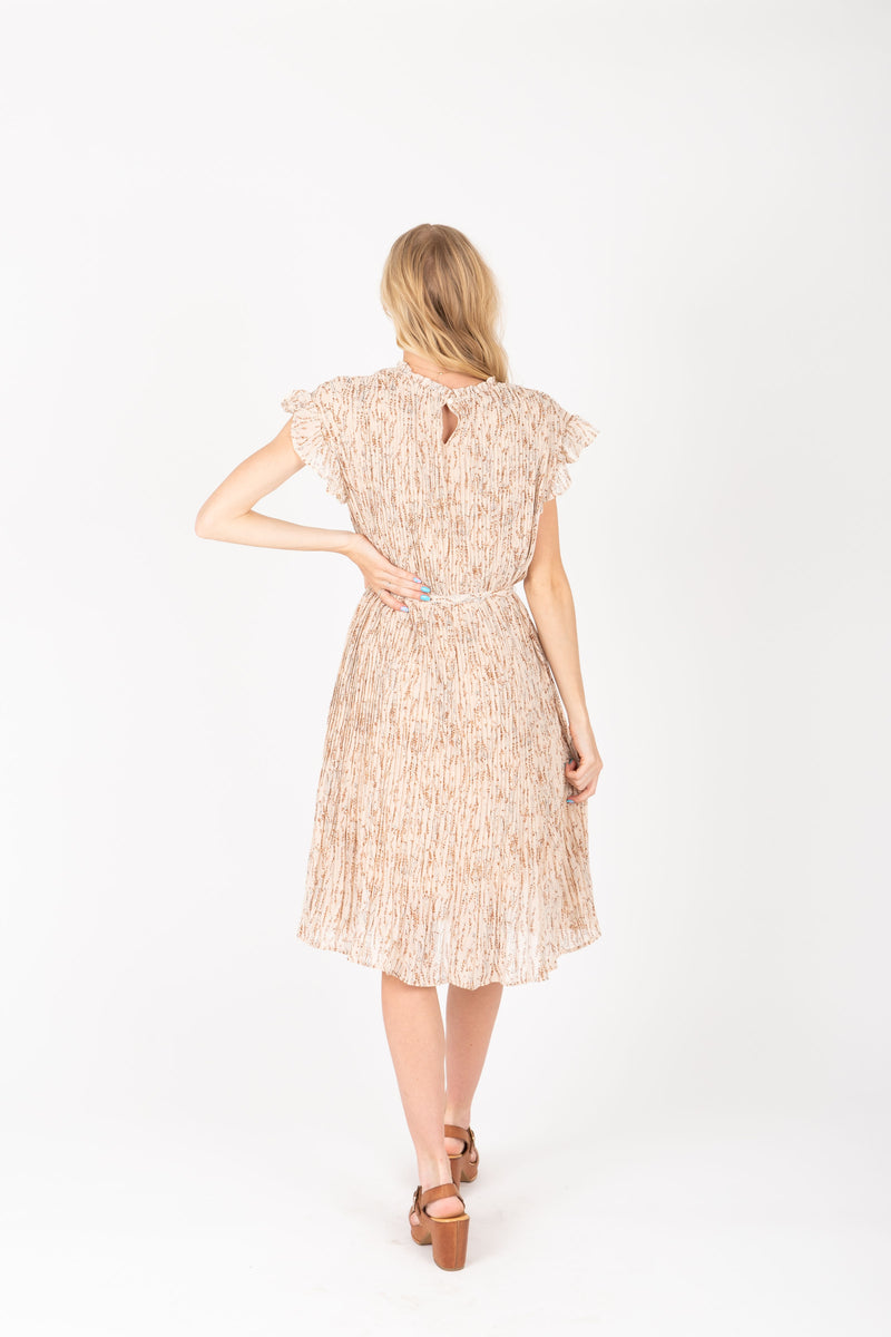 The Harvey Floral Pleated Dress in Taupe, studio shoot; back view