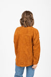 The Icone Frayed Corduroy Jacket in Rust, studio shoot; back view