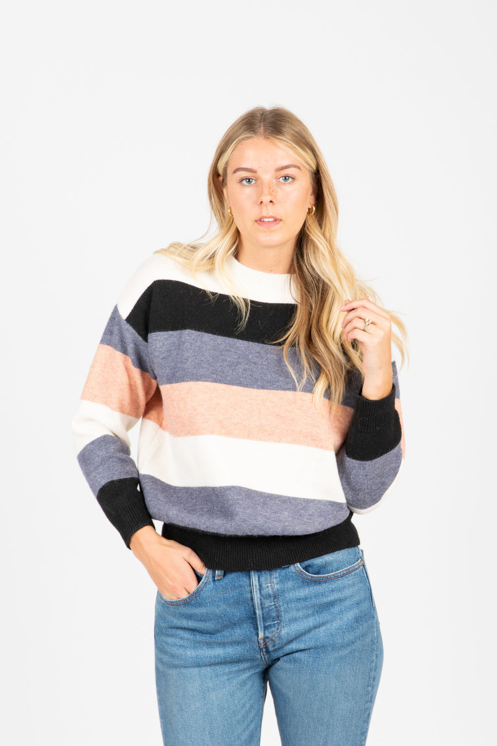 The Welty Striped Sweater in Blush, studio shoot; front view