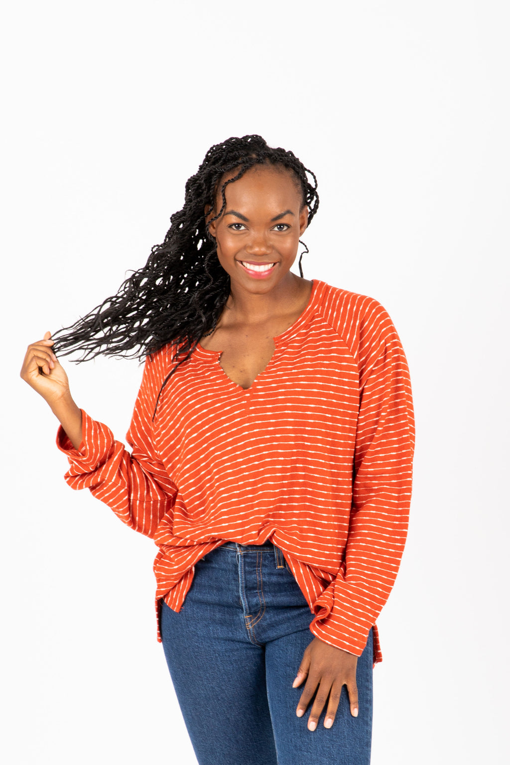The Mishay Striped Slit Blouse in Brick, studio shoot; front view