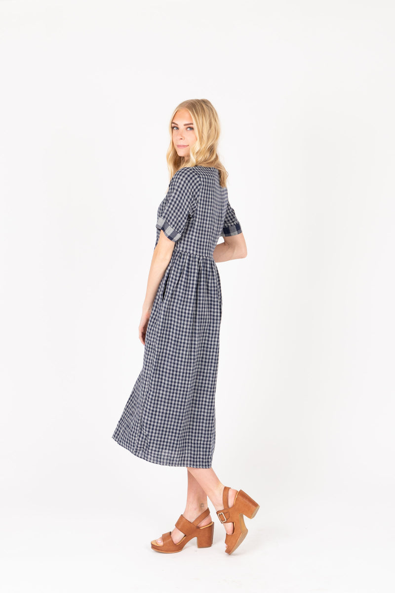The Crosby Gingham Midi Dress in Navy, studio shoot; side view