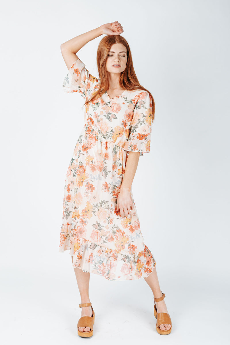 The Burke Floral Dress in Ivory, studio shoot; front view