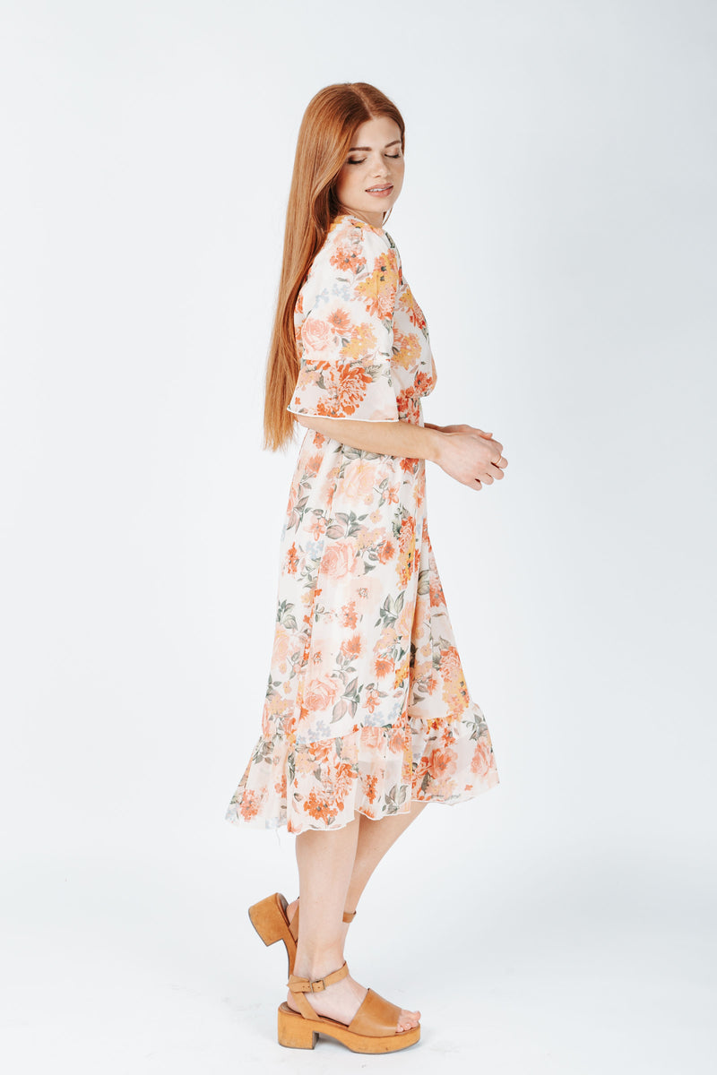The Burke Floral Dress in Ivory, studio shoot; side view