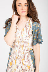 Piper & Scoot: The Gem Contrast Floral Bib Dress in Yellow