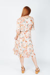 The Burke Floral Dress in Ivory, studio shoot; back view