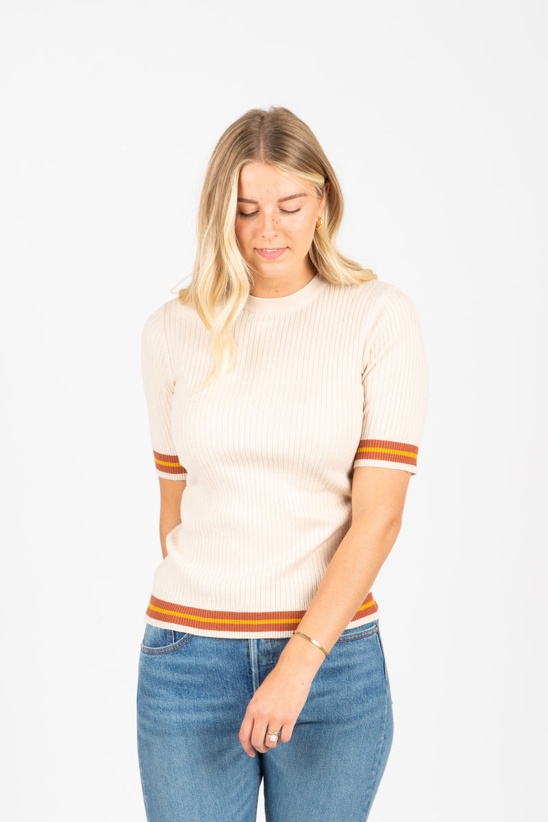 The Durand Striped Trim Ribbed Blouse in Ivory, studio shoot; front view