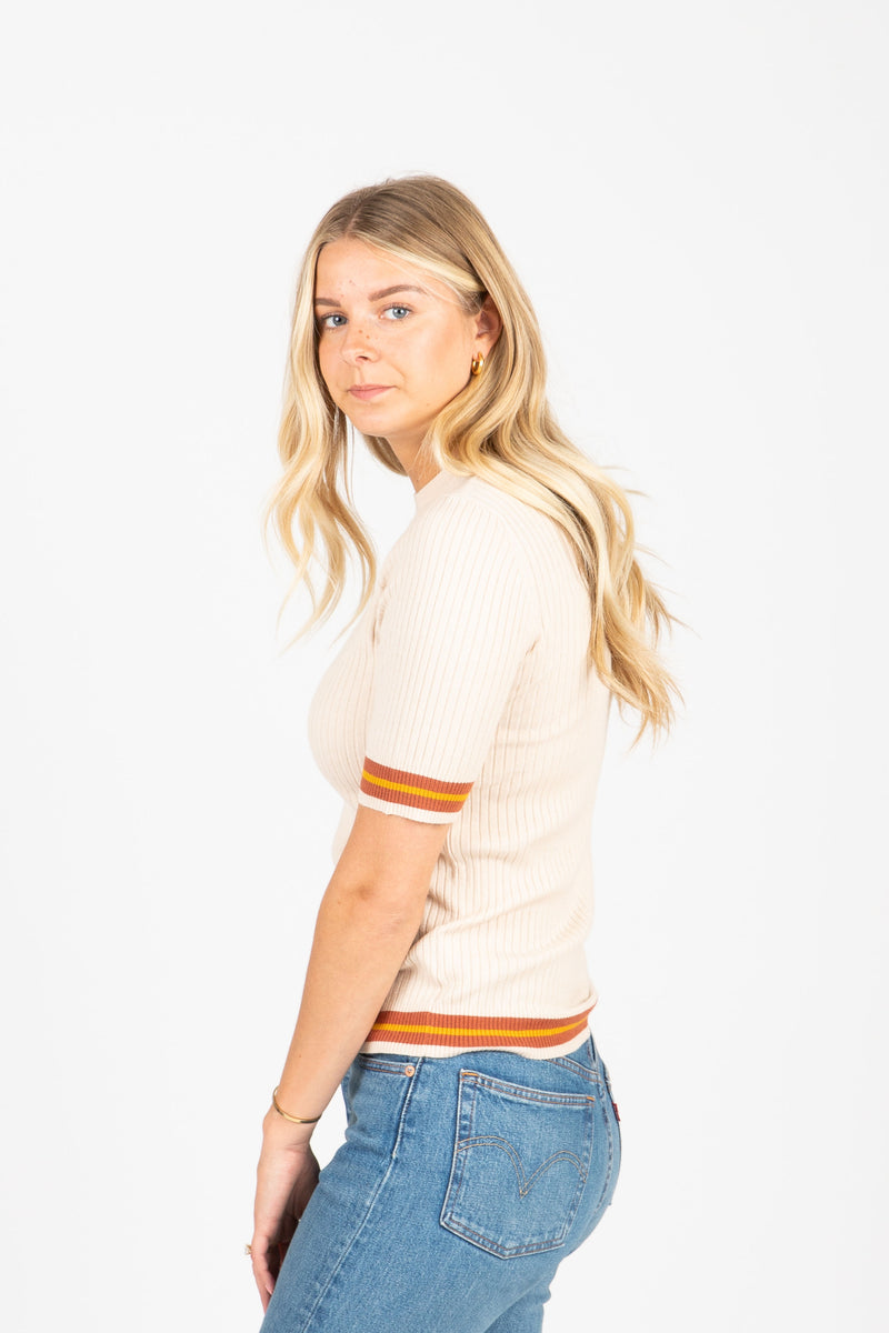 The Durand Striped Trim Ribbed Blouse in Ivory, studio shoot; side view