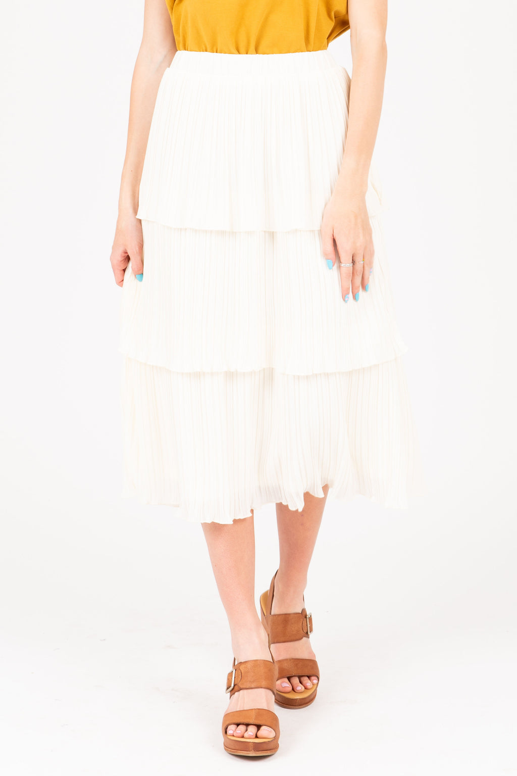 The Vaughn Tiered Pleated Skirt in Ivory, studio shoot; front view