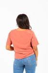 The Naya Scalloped Button Blouse in Brick, studio shoot; back view