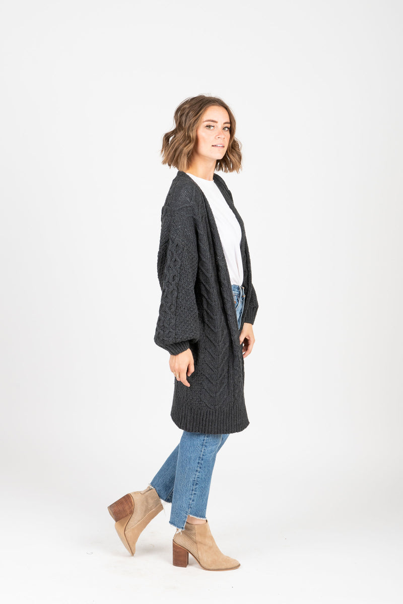 The York Crochet Cardigan in Charcoal, studio shoot; side view