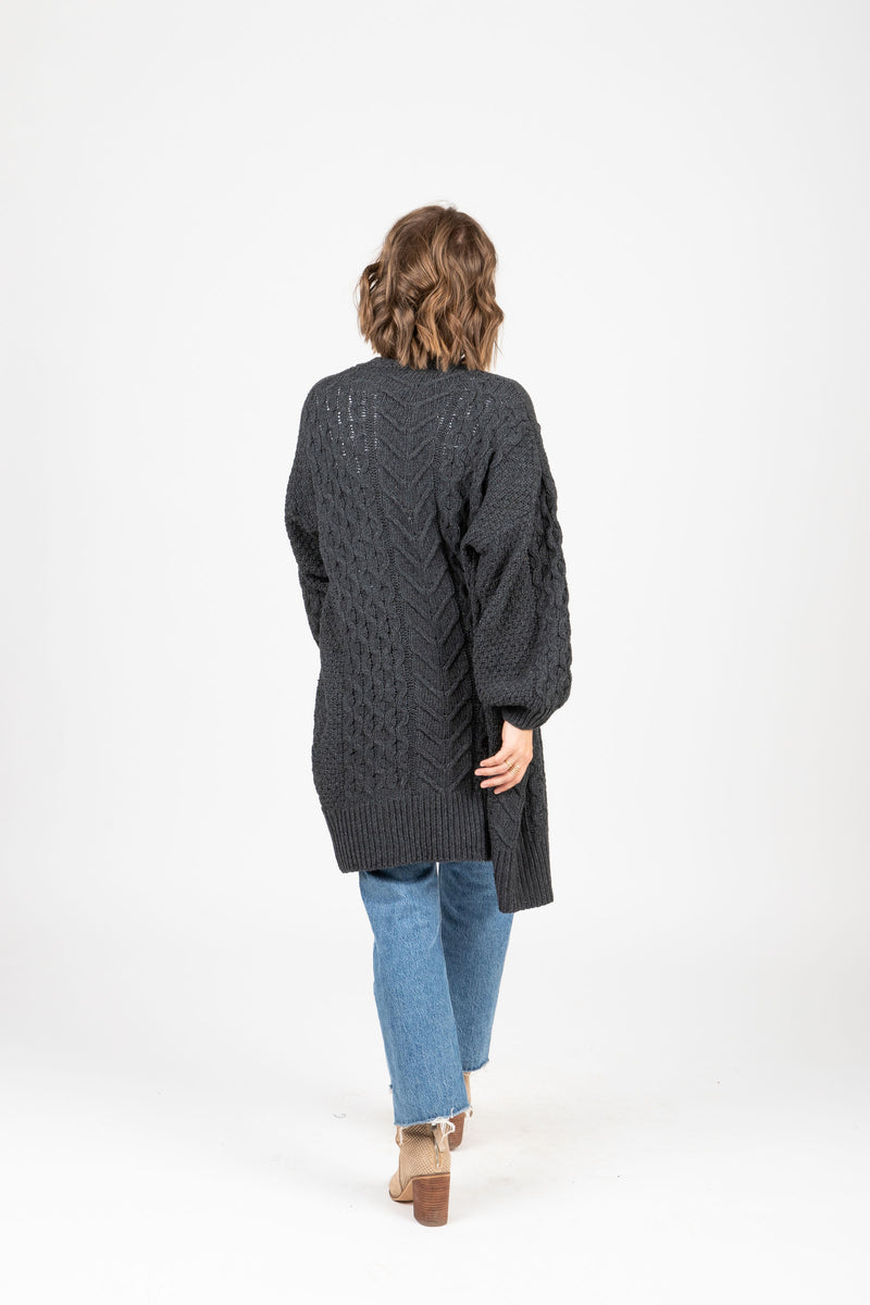 The York Crochet Cardigan in Charcoal, studio shoot; back view