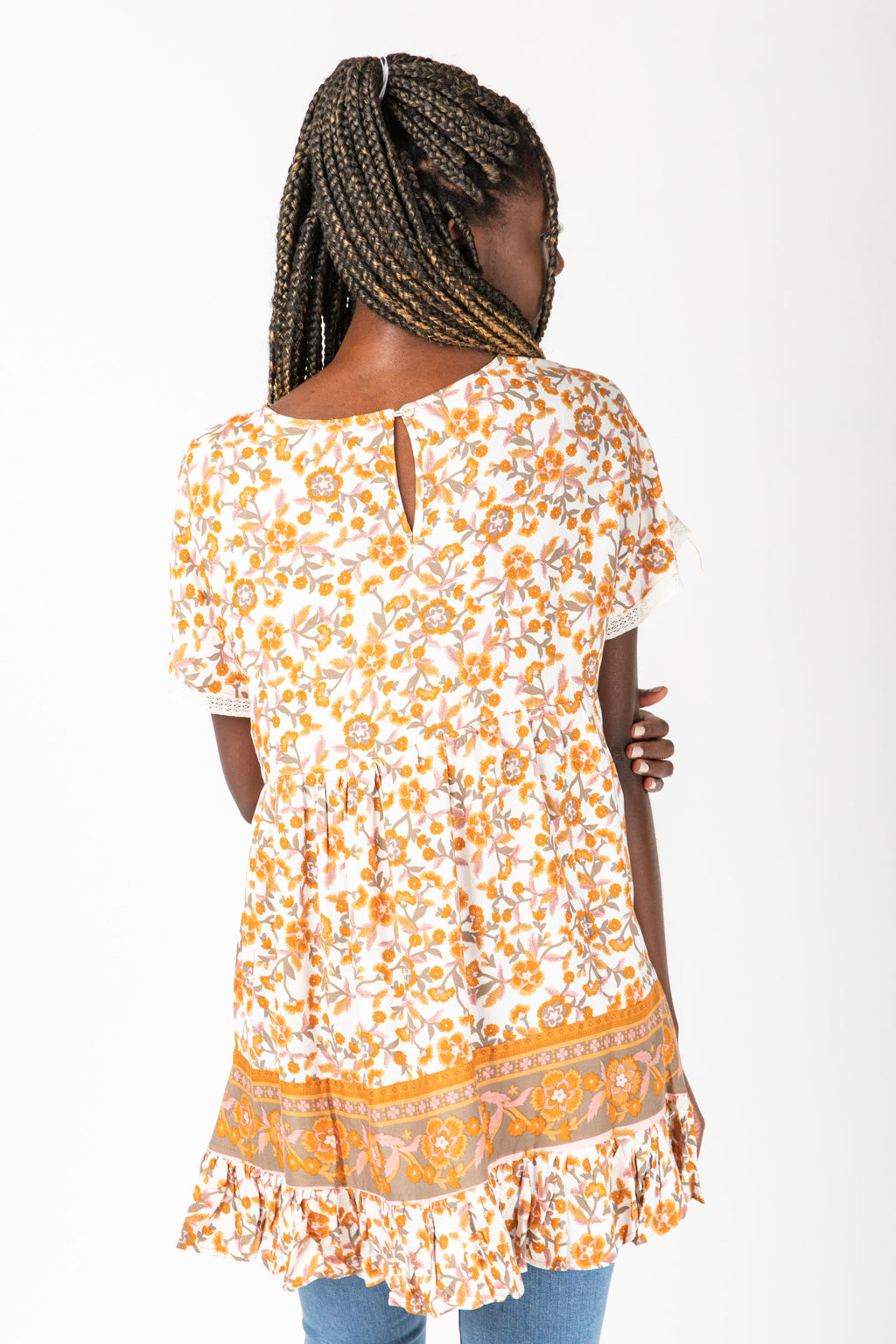 The Damon Patterned Babydoll Blouse in Orange, studio shoot; back view