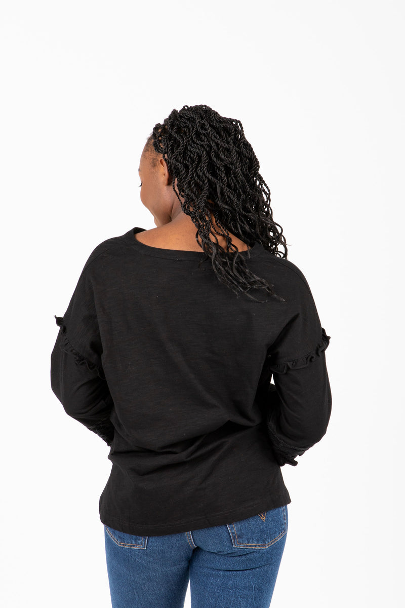 The Gayle Peasant Sleeve Blouse in Black, studio shoot; back view
