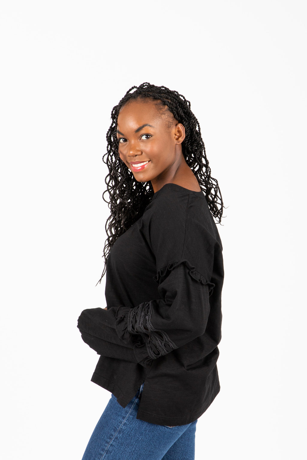 The Gayle Peasant Sleeve Blouse in Black, studio shoot; side view
