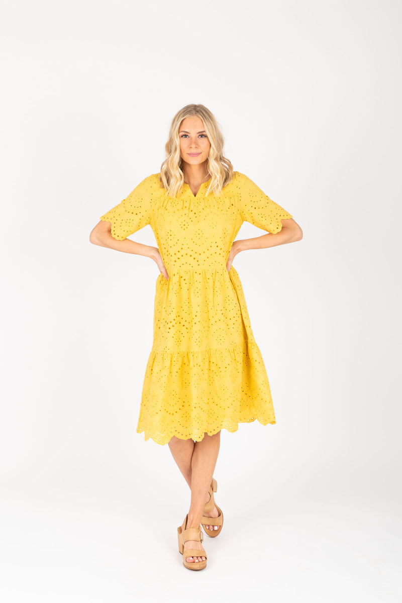 Piper & Scoot: The Brecken Eyelet Tiered Dress in Mustard, studio shoot; front view