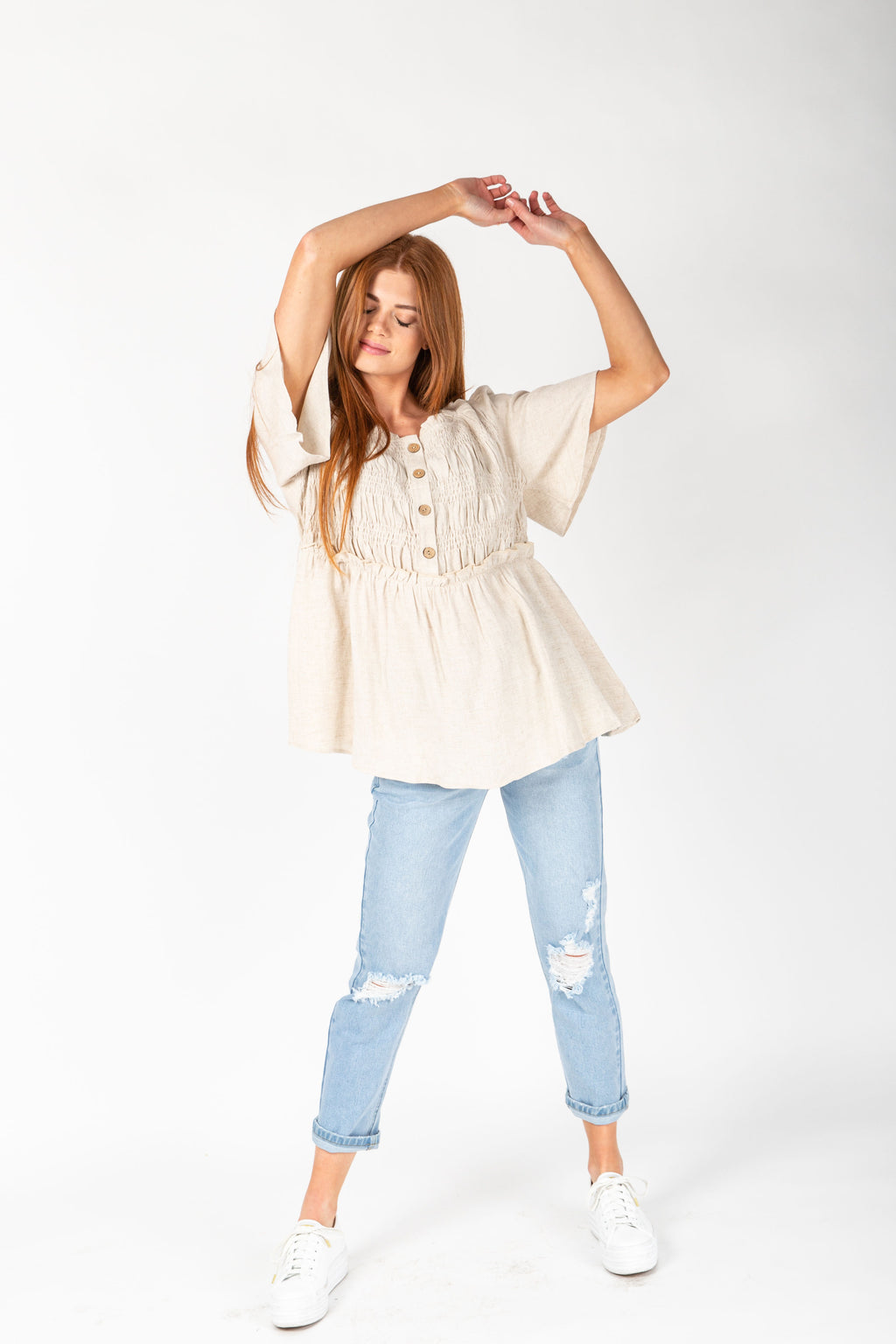The Cece Smocked Blouse in Oatmeal, studio shoot; front view