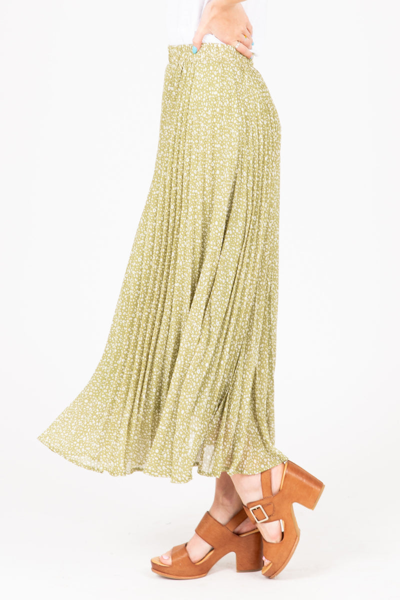 The Gibson Patterned Pleated Maxi Skirt in Dusty Green, studio shoot; side view