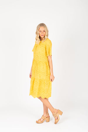 Piper & Scoot: The Brecken Eyelet Tiered Dress in Mustard, studio shoot; side view