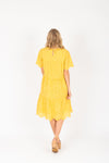 Piper & Scoot: The Brecken Eyelet Tiered Dress in Mustard, studio shoot; back view