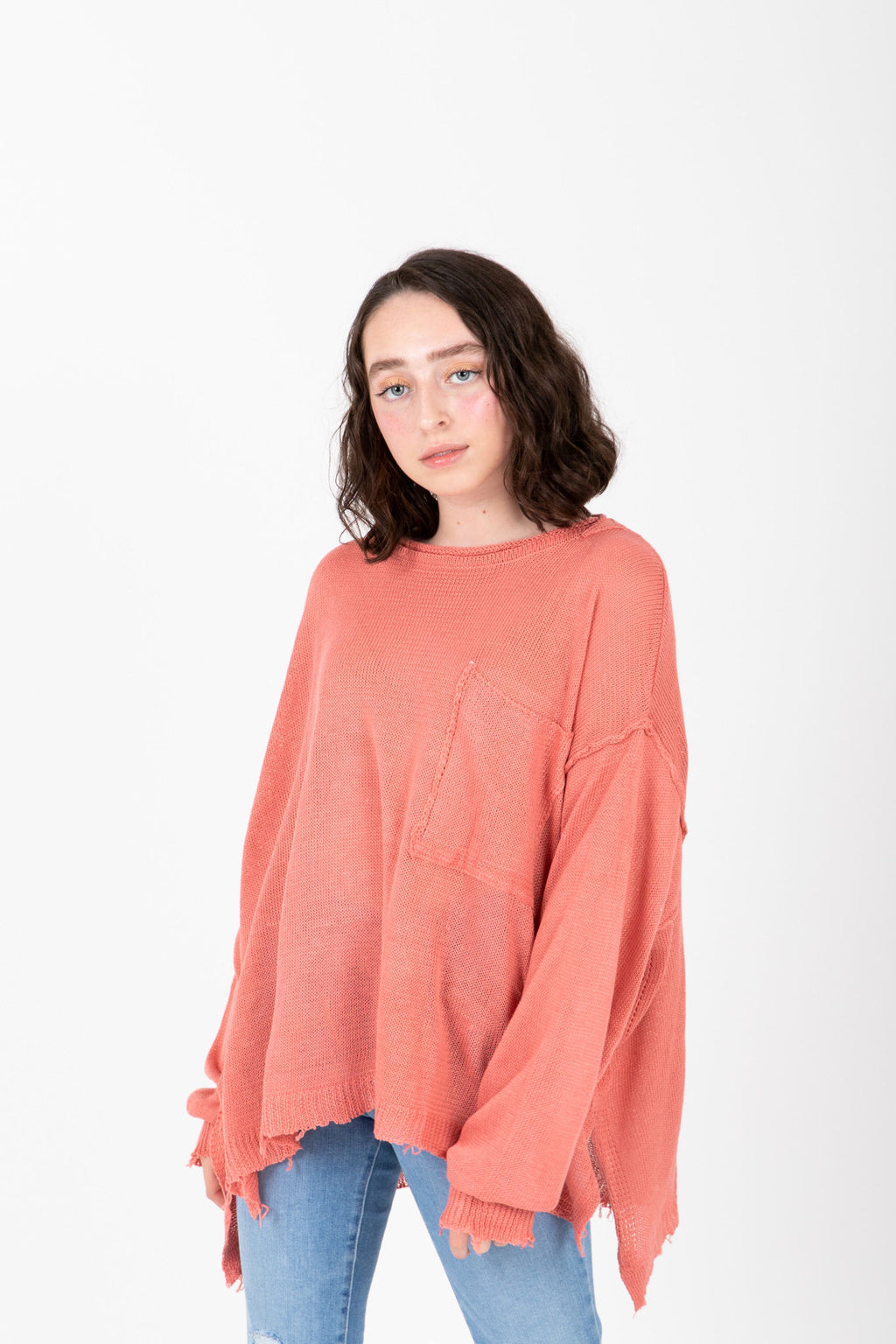 The Vanessa Frayed Pocket Pullover in Rose, studio shoot; front view