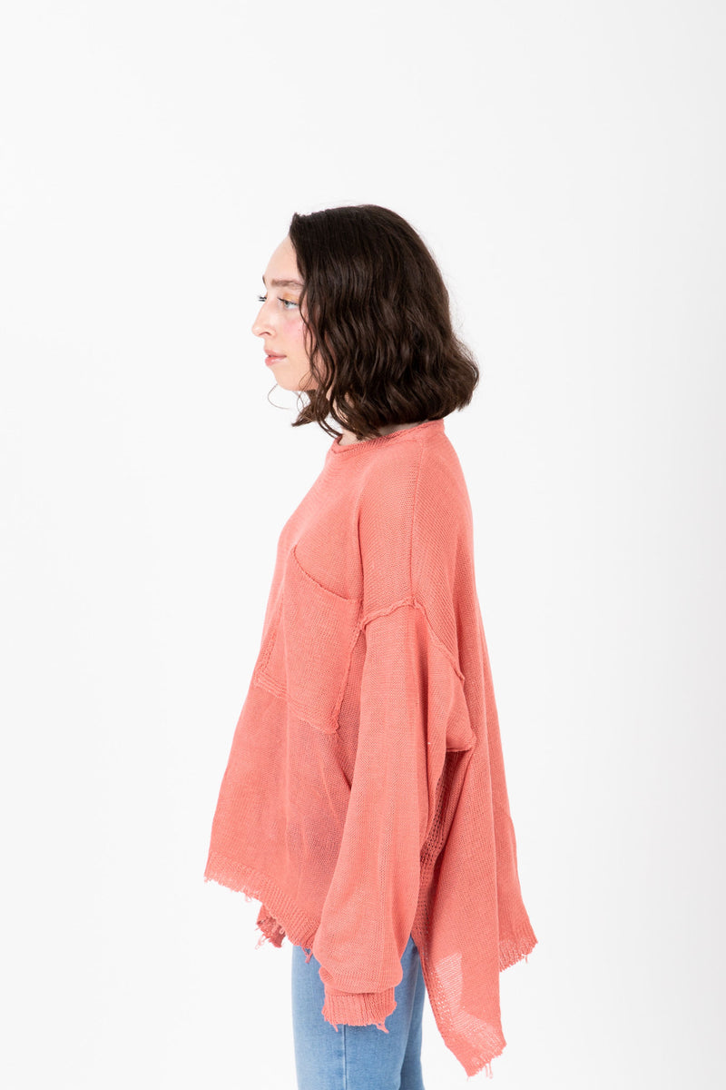 The Vanessa Frayed Pocket Pullover in Rose, studio shoot; side view