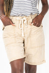 The Hight Drawstring Short in Khaki, studio shoot; front view
