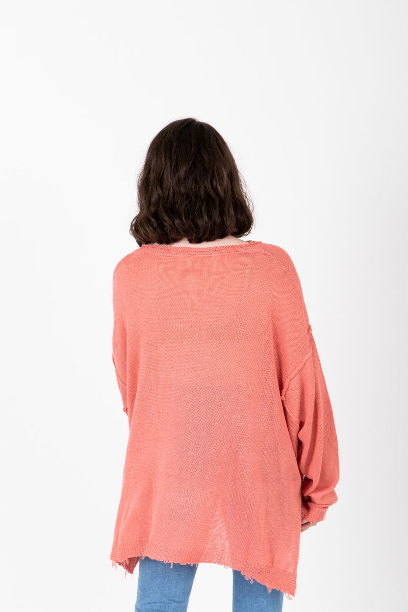 The Vanessa Frayed Pocket Pullover in Rose, studio shoot; back view