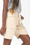 The Hight Drawstring Short in Khaki, studio shoot; side view