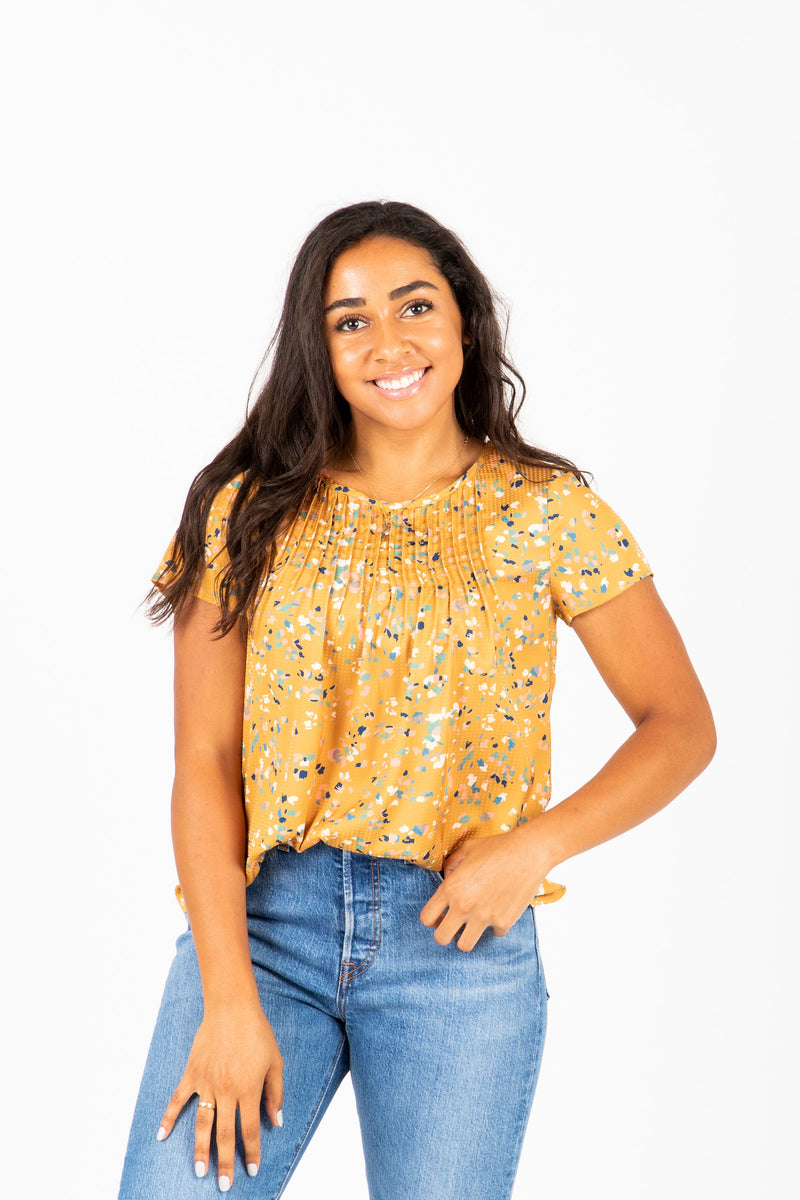 The Lovato Speckled Pleat Blouse in Mustard, studio shoot; front view
