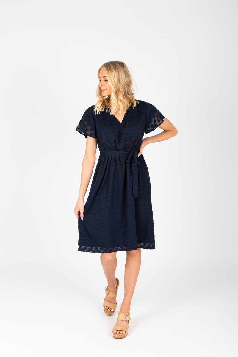 Piper & Scoot: The Evie Dot Wrap Dress in Navy, studio shoot; front view