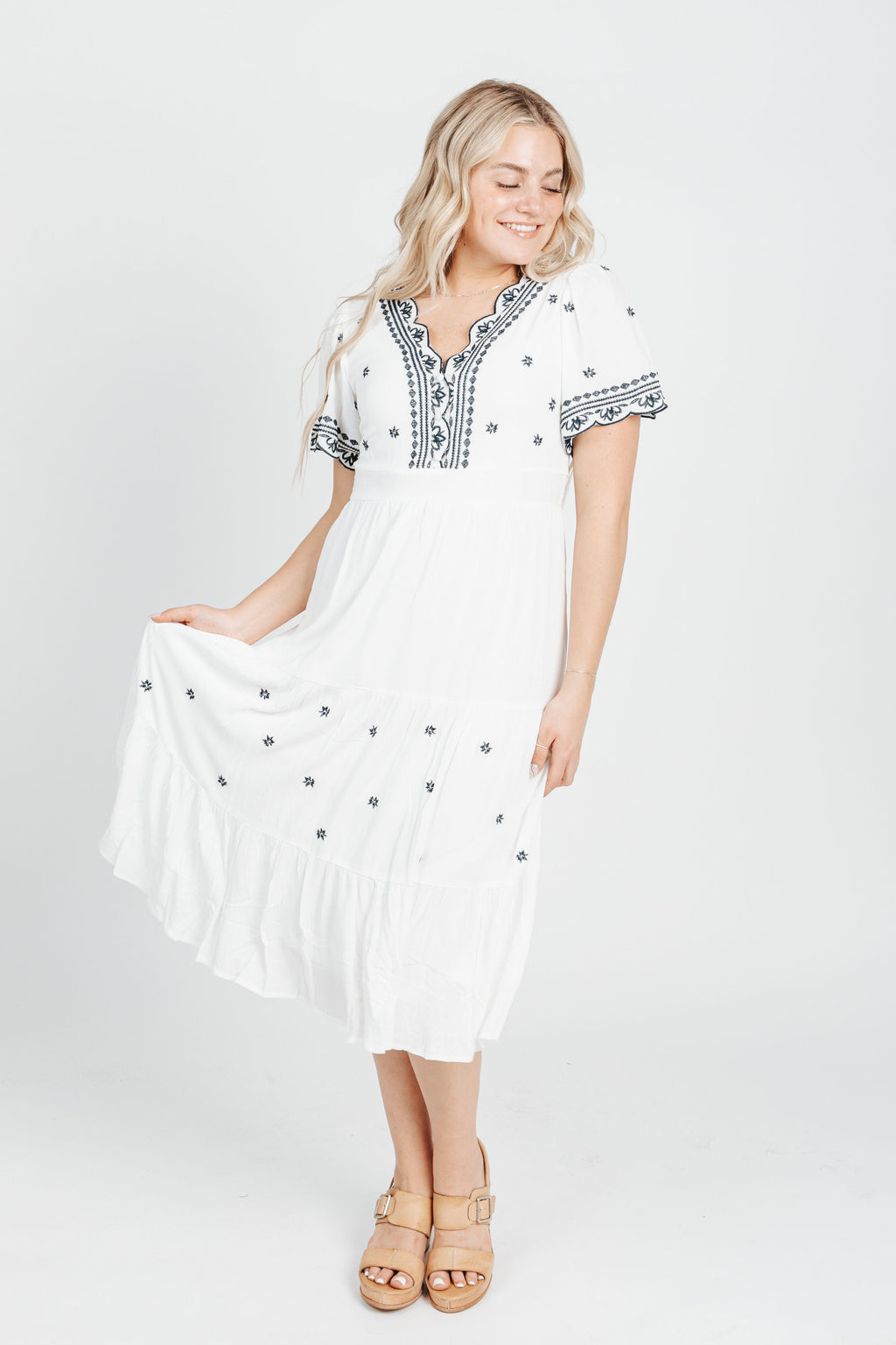 The Robin Embroidered Dress in White, studio shoot; front view