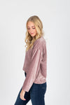 The Coretta Ribbed Velvet Mock Neck in Rose, studio shoot; side view