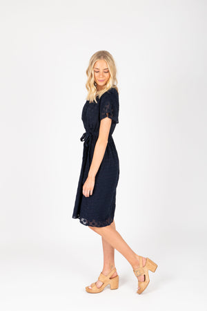 Piper & Scoot: The Evie Dot Wrap Dress in Navy, studio shoot; side view
