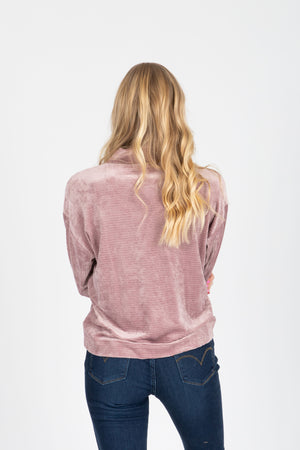 The Coretta Ribbed Velvet Mock Neck in Rose, studio shoot; back view