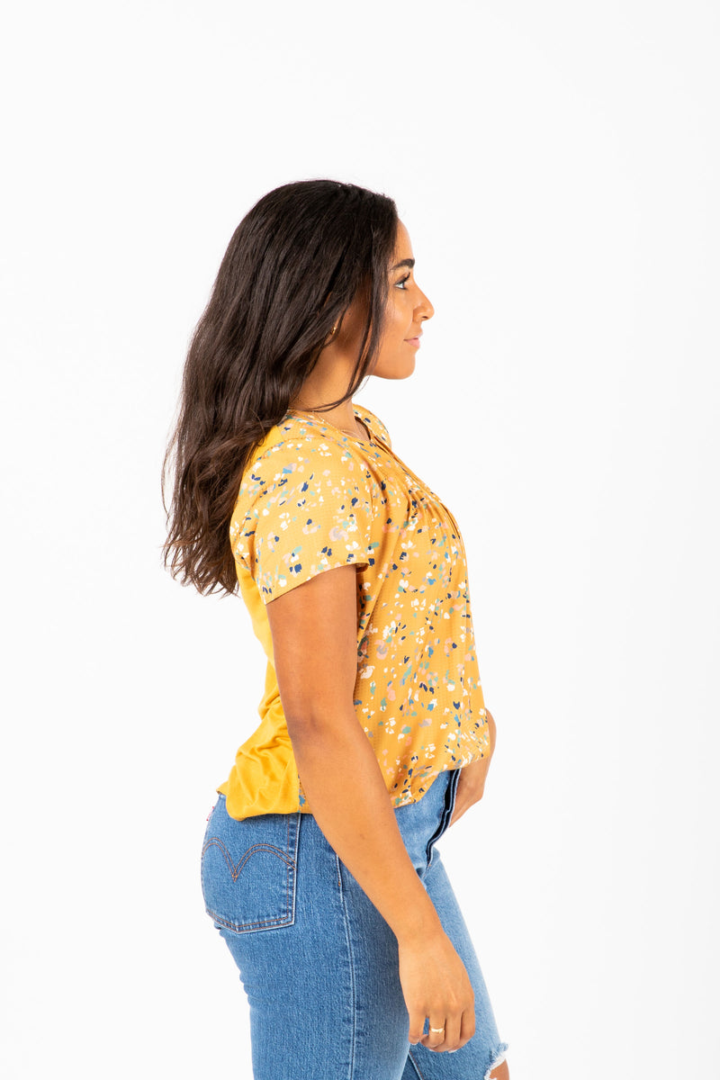 The Lovato Speckled Pleat Blouse in Mustard, studio shoot; side view